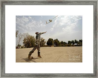 U.s. Army Soldier Launches An Rq-11b Framed Print by Stocktrek Images