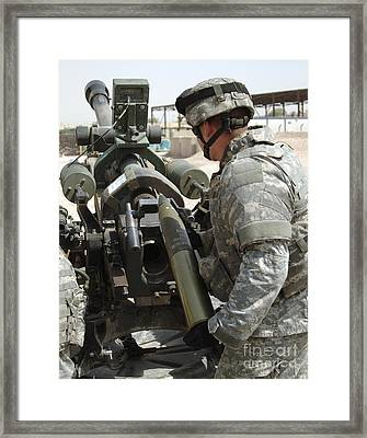U.s. Army Soldier Loads A 105mm Framed Print by Stocktrek Images