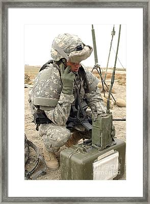 U.s. Army Soldier Performs A Radio Framed Print by Stocktrek Images