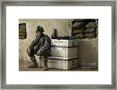 U.s. Army Soldier Relaxing Before Going Framed Print by Stocktrek Images