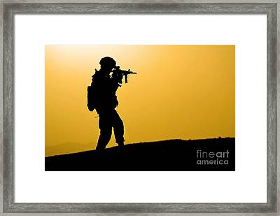 U.s. Army Soldier Secures An Area Framed Print