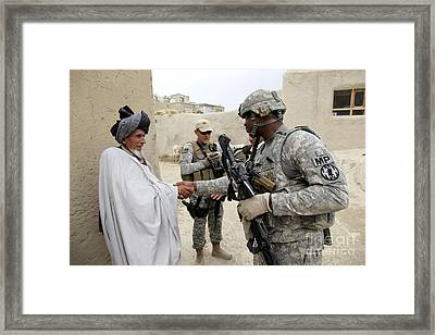 U.s. Army Soldier Shakes Hands With An Framed Print