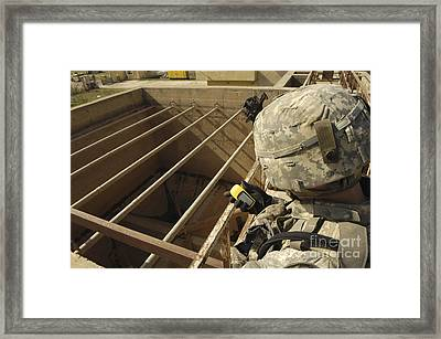 U.s. Army Soldier Takes A Gps Grid Framed Print by Stocktrek Images