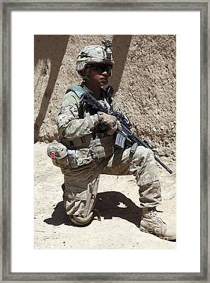 U.s. Army Soldier Takes A Knee While Framed Print