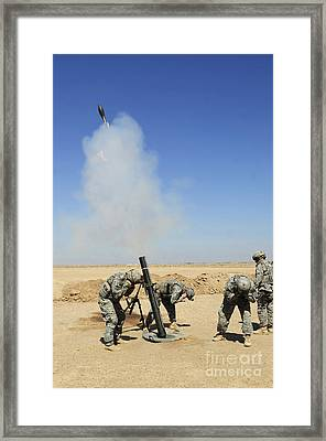 U.s. Army Soldiers Firing An M120 120mm Framed Print by Stocktrek Images