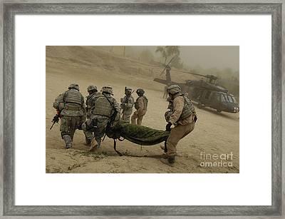 U.s. Army Soldiers Medically Evacuate Framed Print by Stocktrek Images