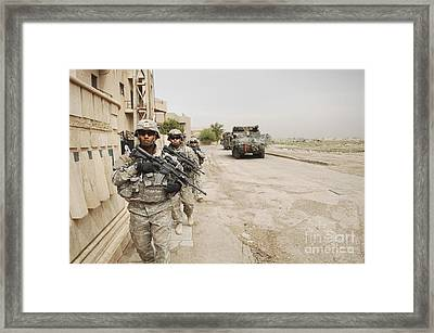 U.s. Army Soldiers Moving To Their Next Framed Print by Stocktrek Images