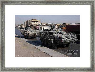 U.s. Army Soldiers Patrolling Framed Print by Stocktrek Images