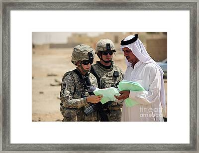 U.s. Army Soldiers Talking With A Town Framed Print by Stocktrek Images