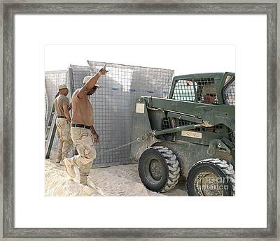U.s. Army Soldiers Use A Bobcat S150 Framed Print by Stocktrek Images