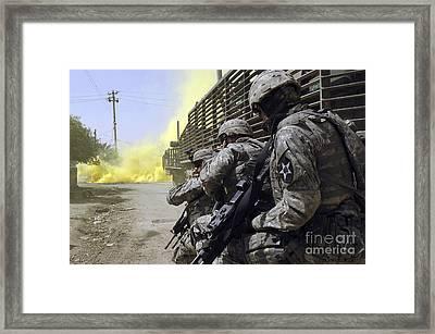 U.s. Army Soldiers Using Smoke Grenades Framed Print by Stocktrek Images