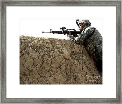 U.s. Army Specialist Looking Framed Print by Stocktrek Images