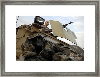 U.s. Army Specialist Prepares Framed Print by Stocktrek Images