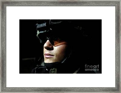 U.s. Army Specialist Waits To Dismount Framed Print by Stocktrek Images