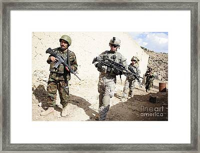 U.s. Army Troops Lead A Patrol Framed Print