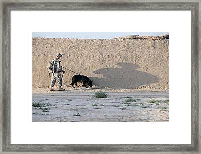 Us Army Working Dog Team Conducts Framed Print