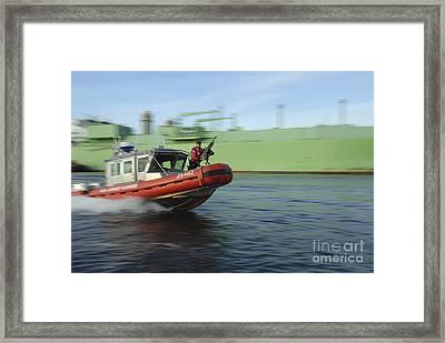 U.s. Coast Guard Officer Mans A M240b Framed Print by Stocktrek Images