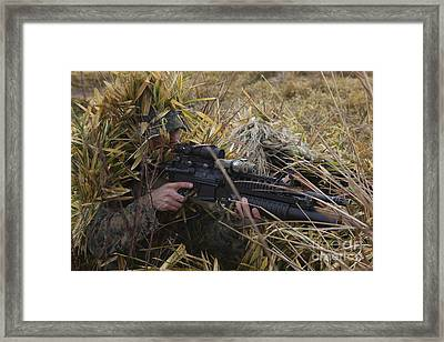 U.s. Marine Aims In On Target Framed Print by Stocktrek Images