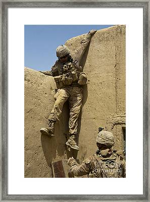 U.s. Marine Climbs Down From An Framed Print by Stocktrek Images