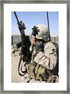 U.s. Marine Communicates With Fellow Framed Print by Stocktrek Images