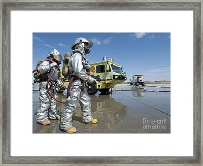 U.s. Marine Firefighters Stand Ready Framed Print by Stocktrek Images