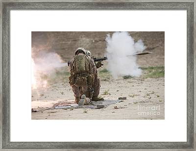 U.s. Marine Fires A Rocket-propelled Framed Print