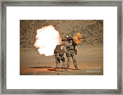 U.s. Marine Fires A Rpg-7 Grenade Framed Print by Terry Moore