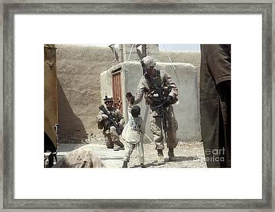 U.s. Marine Gives An Afghan Child Framed Print by Stocktrek Images