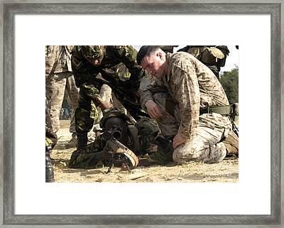 U.s. Marine Helps A Member Framed Print by Stocktrek Images