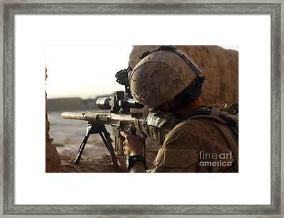 U.s. Marine Looks Through The Scope Framed Print by Stocktrek Images