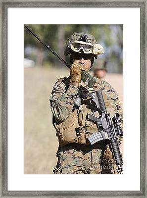 U.s. Marine Radios His Units Movements Framed Print by Stocktrek Images