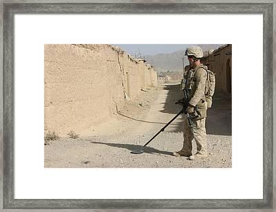 U.s. Marine Sweeping For Improvised Framed Print by Everett