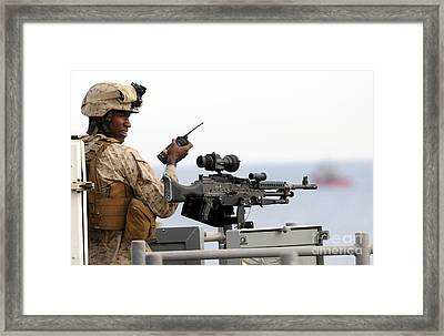 U.s. Marine Talks On A Radio While Framed Print by Stocktrek Images