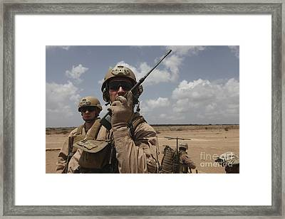 U.s. Marine Uses A Radio In Djibouti Framed Print by Stocktrek Images