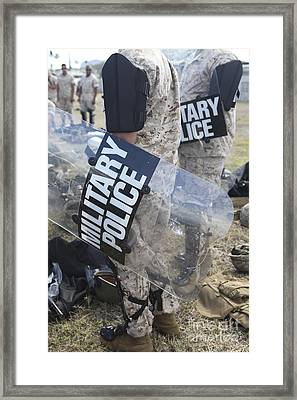 U.s. Marines And Sailors Don Riot Gear Framed Print by Stocktrek Images