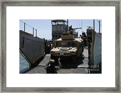 U.s. Marines Load An M1114 Humvee Onto Framed Print