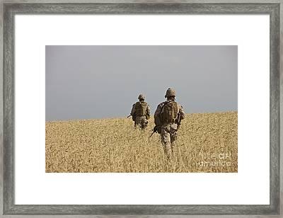 U.s. Marines Patrol A Wadi Near Kunduz Framed Print by Terry Moore