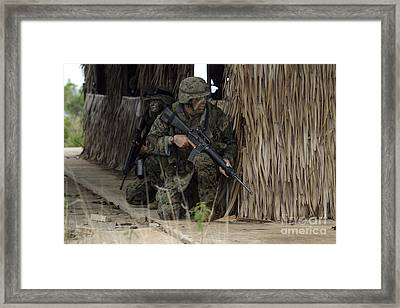 U.s. Marines Prepare To Enter A House Framed Print by Stocktrek Images