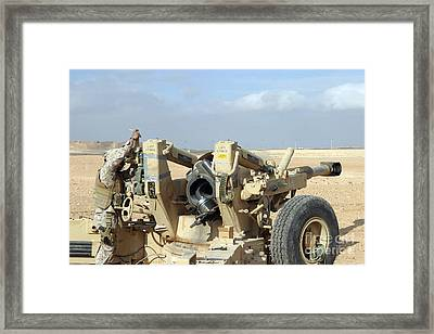 U.s. Marines Prepare To Fire A Howitzer Framed Print by Stocktrek Images