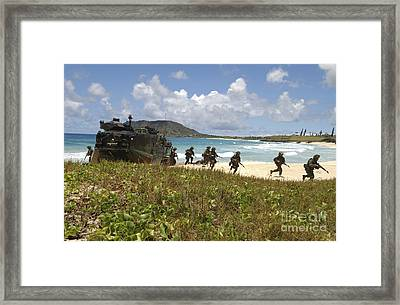 U.s. Marines Run Out Of An Amphibious Framed Print by Stocktrek Images