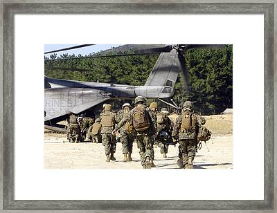 U.s. Navy Corpsmen Carry Wounded Framed Print by Stocktrek Images