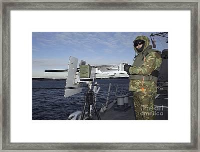 U.s. Navy Petty Officer Mans A .50 Framed Print by Stocktrek Images