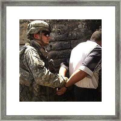 Us Soldier Cuffs An Iraqi Man Suspected Framed Print