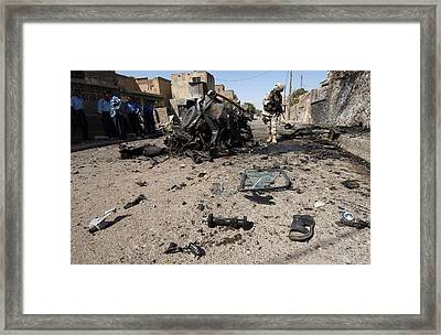 Us Soldier Inspects The Area Framed Print by Everett