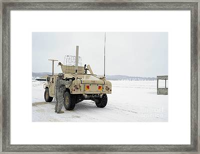U.s. Soldier Takes Cover Framed Print by Stocktrek Images