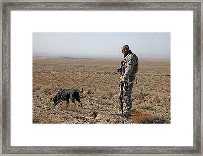 Us Soldier Works With A Dog Identified Framed Print