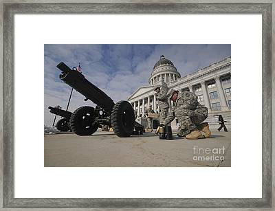 U.s. Soldiers Clean Up After Firing Framed Print by Stocktrek Images