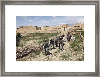 U.s. Soldiers Conduct A Dismounted Framed Print