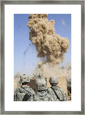 Us Soldiers Destroy An Insurgent Framed Print