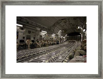 U.s. Soldiers Relax During A Flight Framed Print